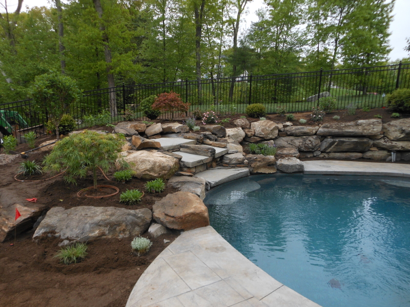 Nh waterfall pool area landscaping design installation for Landscape design for pool areas